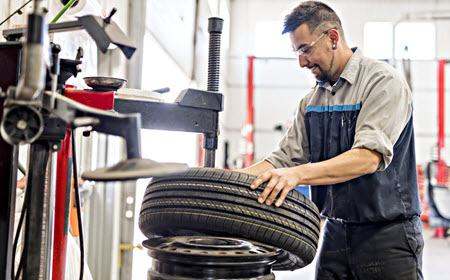 Mechanic Checking Car Tire